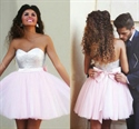 Light Pink Strapless Tulle Homecoming Dress With Sequin Bodice And Bow