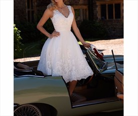 Cute White Sleeveless Tea Length Cocktail Dress With Lace Embellished