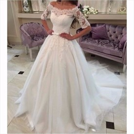 Elegant Ivory Off Shoulder Lace Embellished Ball Gown Wedding Dress