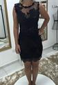 Black Sleeveless Lace Short Sheath Cocktail Dress With Sheer Neckline