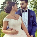 Light Pink Off The Shoulder Lace Embellished Ball Gown Wedding Dress